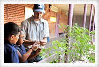 student learning about plants with teacher